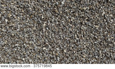 The Texture Of Stone Gravel Gray. Stone Rubble Gray Poured Pile Close-up.