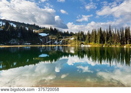Serenity lake in the mountains in summer season. Beautiful natural landscapes.