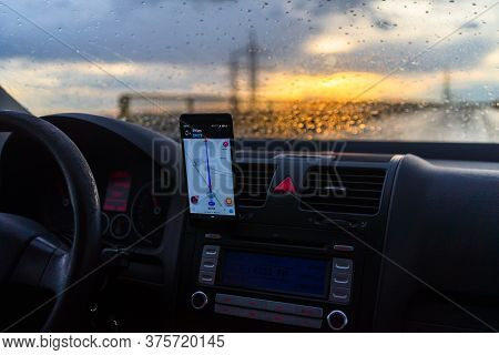 Using Waze Maps Application On Smartphone On Car Dashboard, Driver Using Maps App For Showing The Ri