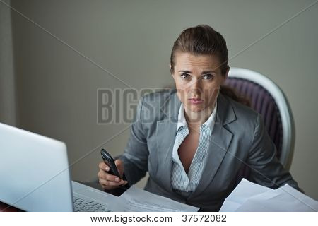 Sorrowful Business Woman Working At Desk