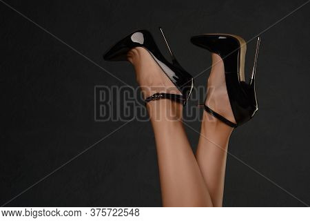 Slender Female Legs In A Fetish Shoe With Extremely High Heels. Bdsm Theme.