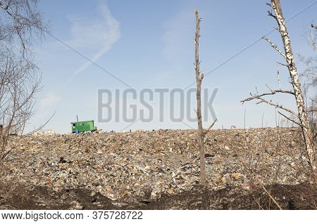 The Garbage Dump Of A Big City, A Green House In Which The Homeless Live. Blue Sky