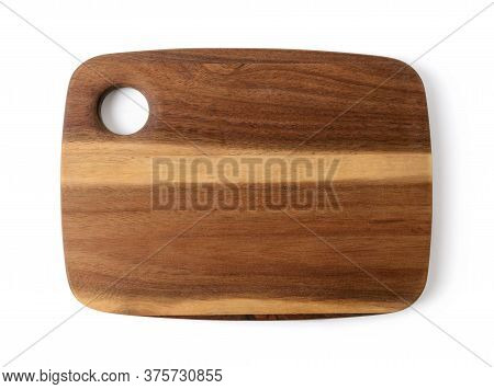 New Cutting Or Serving Board Of Acacia Wood Isolated On White Background. New Rectangular Chopping B