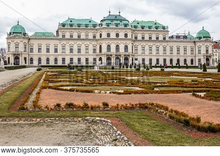 Vienna, Austria - March 6, 2017: View Of People Walking In Belvedere Garden With Upper Belvedere Pal