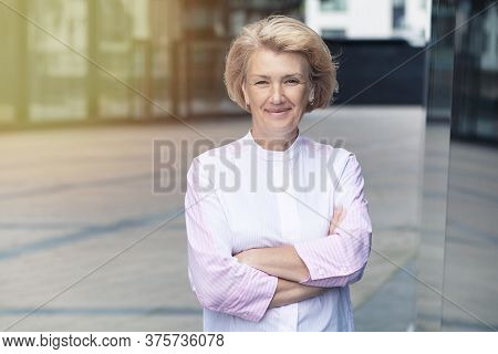Cheerful Positive Lady With Her Hands Crossed. Portrait Of Happy Beautiful Senior Mature Adult Woman