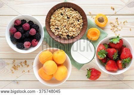 Healthy Breakfast Ingredients Muesli, Granola, Milk, Fruits, Strawberry And Blackberries On White Ba