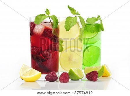 Three refreshing drinks in glasess with mint and ice isolated poster