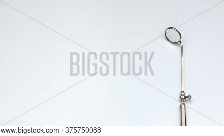 The Mirror Of The Dentist's Equipment, White Background