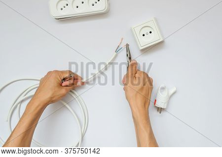The Work Process Of An Electrician, Close View, White Background