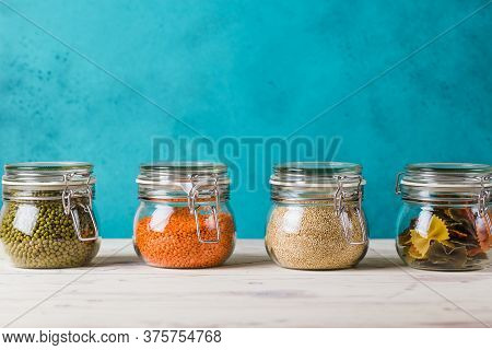 Glass Boxes And Bottles With Quinoa, Lentil, Mash, Pasta Organized Home Simple Stylish Storage No Pl