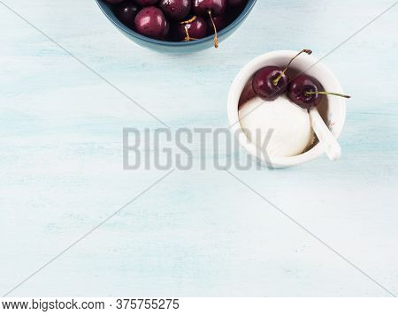 Frozen Yogurt Dessert In Cup With Cherries. Fresh Gelato On Turquoise Background. Flat Lay, Copy Spa
