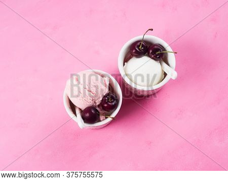 Two Cups With Frozen Gelato Sundae With Cherries On Pink Background. Overhead Shot