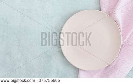 Empty Pink Plate On Grey Stone Table And Napkin. Food Background For Menu, Recipe. Table Setting. Fl