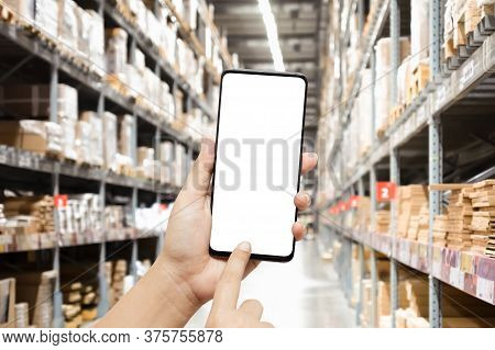Close-up Hands Using Smartphone In Warehouse Industry Blur Background For Logistic Wholesale Storeho