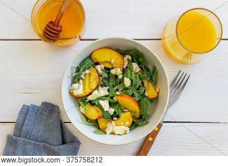 Salad With Peach, Arugula, Cheese, Nuts And Honey. Healthy Eating. Vegetarian Food. Recipe.