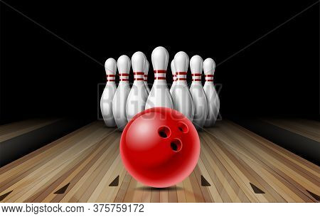 Red Glossy Ball Rolling On Bowling Alley Line To Ten Placed In Order White Bowling Pins.