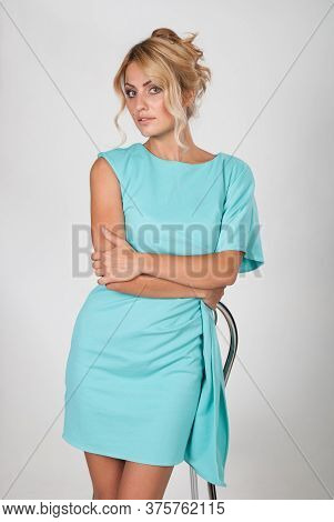 Portrait Of A Young Beautiful Woman In A Light Blue Dress