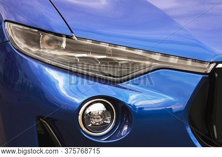 Car Headlights. Luxury Headlights. Part Of A Blue Car.