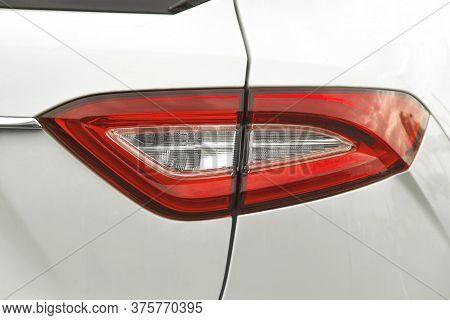 Part Of A White Luxury Car Close Up. Car Headlights. Luxury Headlights