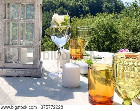 Served Festive Table. Wedding Serving. White Tablecloth With Plates And Decor In Garden. Wedding Con