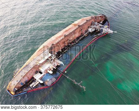 A Tanker That Sank On The Seashore, An Environmental Catastrophe, Pollution Of Fuel And Oil Products