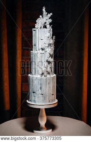 Amazing Cakes. Chocolate Wedding Cake White Cake On A Black Background.large Cake In White Chocolate