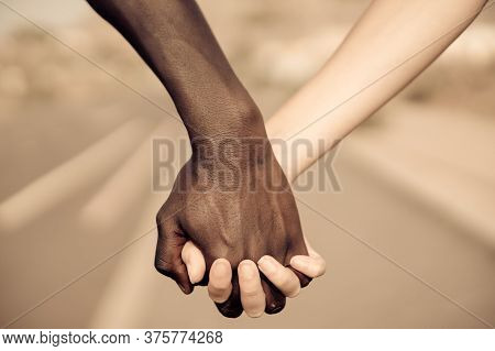 Hands For Africa Union Peace Love. No To Racism! Black African Man Holds Hands With A Caucasian Woma