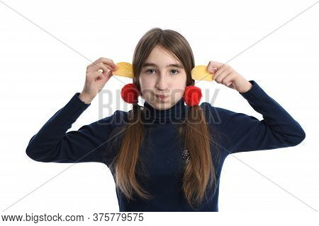 Portrait Of Pre-adolescent Girl Holding Potato Chips. Isolated On White Background. High Resolution