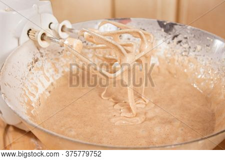 Mixer Blades Based On A Bowl With Crumbled Dough. Dough Flows From The Mixer Blades.