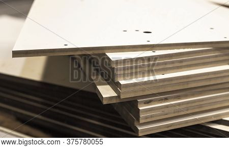 Stacked Textolite Sheets. This Is Layered Composite Material Based On Fabric From Fibers And A Polym