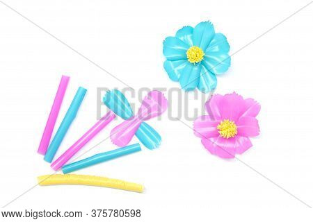 Recycling Used Plastic Tubes Used To Make Cosmos Flowers Isolated On White Background.