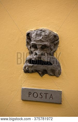 Vintage Mailbox Gap On Old Building Wall. Slot With Inscription Posta Or Mail On Metal Plate And Biz