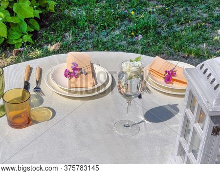 Table Set For Dinner. Festive Table Setting. Wedding, Celebration, Party. Terrace, Restaurant. White