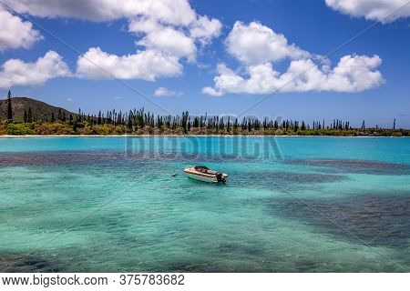 Fishing Boat Anchored By The Coast Of Isle Of Pines, New Caledonia