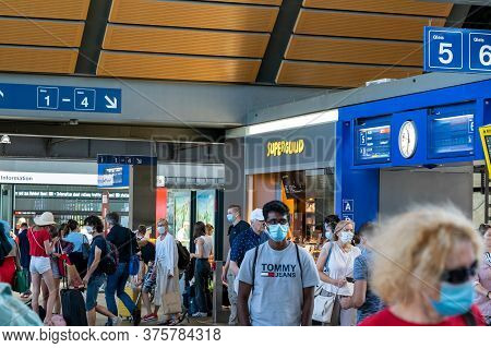 Basel, Bl / Switzerland - 8 July 2020: Swiss Government Regulations Require Travellers To Wear Face
