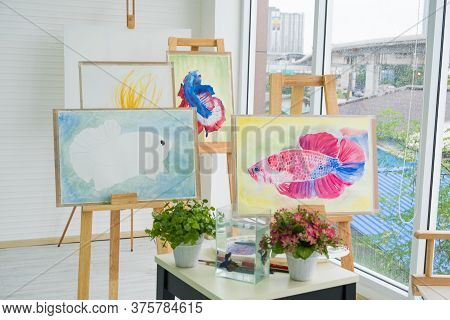 Artistic Work Of The Painter Who Set Up His Beautiful Fish Painting. Portfolio At His Studio.