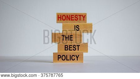 Wooden Blocks Form The Words \'honesty Is The Best Policy\' On White Background. Business Concept. C