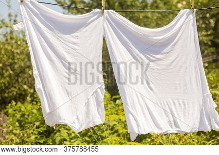 Washed White T-shirts Are Dried In The Fresh Air In The Village.