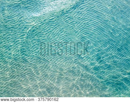 Clear Water And Clear Bottom In The Balearic Islands In Spain.