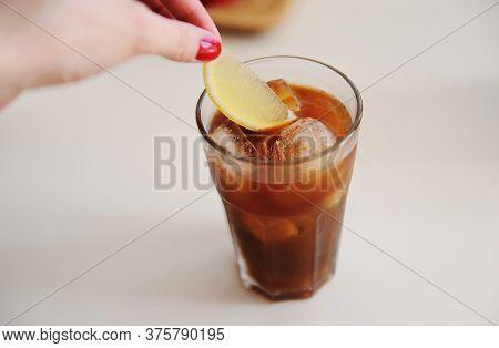 Making Espresso Tonic. Adding A Lemon Slice Into Espresso Tonic