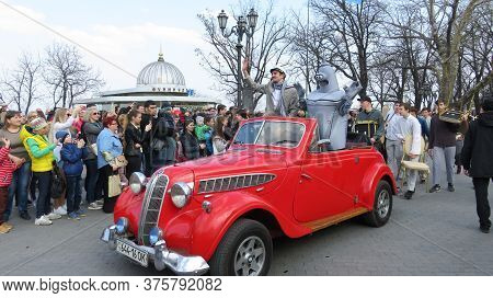 Odessa, Ukraine - 04 01 2019: Vintage Bright Red Retro Car With A Robot And A Cheating Book Hero On