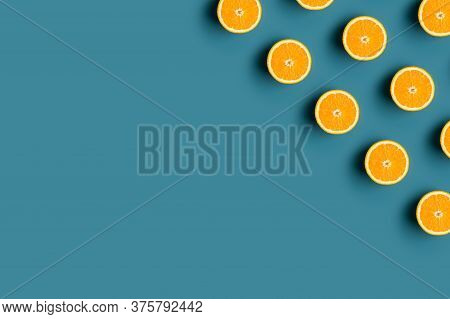 Minimal Modern Pattern In The Corner With Ripe Orange Fruit At Blue Background. Concept Of Fresh Raw