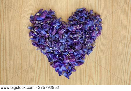 Vintage Heart From Flower Petals On Wooden Table. Valentin Day Background