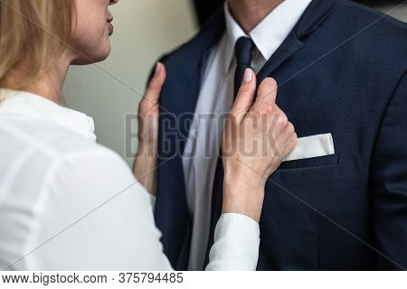 Caucasian Woman Straightens Businessmans Collar. Passionate Flirting Business People. Love Affair In