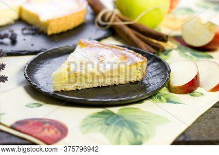 Homemade Apple Pie Slice On Rustic Black Plate Closeup