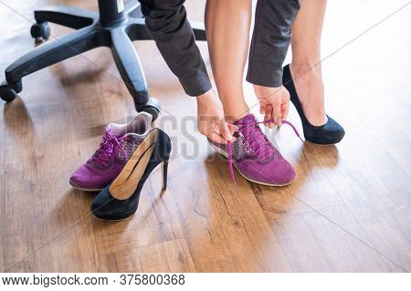 Close-up Of Legs Of An Office Female Employee With Foot Pain. A Woman Changes High Black Suede Heels