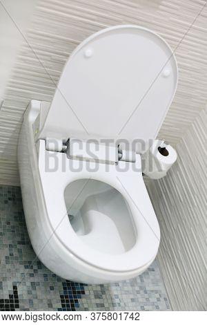 White Toilet bowl in bathroom.