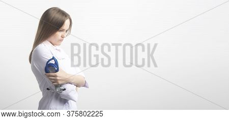 Confident Sad Woman Doctor Standing With Crossed Arms With Stethoscope. Isolated Female Portrait. Co
