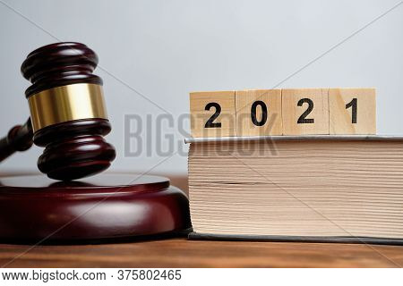 The Concept Of New Laws In 2021 Next To The Judge Hammer.