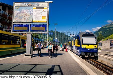 Grindelwald, Switzerland - July 30 2019 : Train Of The Berner Oberland Bahn Waiting In The Railway S